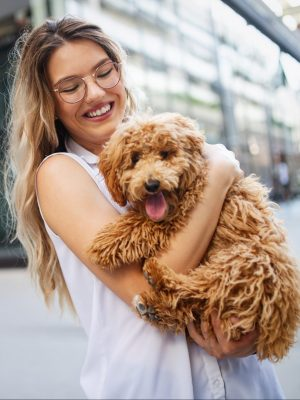 beauty-woman-with-her-dog-playing-outdoors-LN2XF4U-min